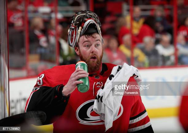 Scott Darling of the Carolina Hurricanes gets a drink during a timeout an NHL game against the Dallas Stars on November 13 2017 at PNC Arena in...