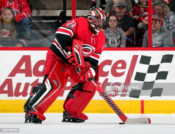 Scott Darling of the Carolina Hurricanes leaves the crease to play the puck during an NHL game against the Minnesota Wild on October 7 2017 at PNC...