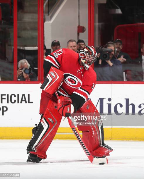 Scott Darling of the Carolina Hurricanes plays a puck outside the crease during an NHL game against the Dallas Stars on November 13 2017 at PNC Arena...