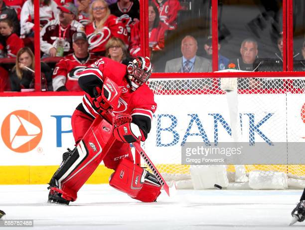Scott Darling of the Carolina Hurricanes skates out of the crease to play a puck against the Minnesota Wild during an NHL game on October 7 2017 at...