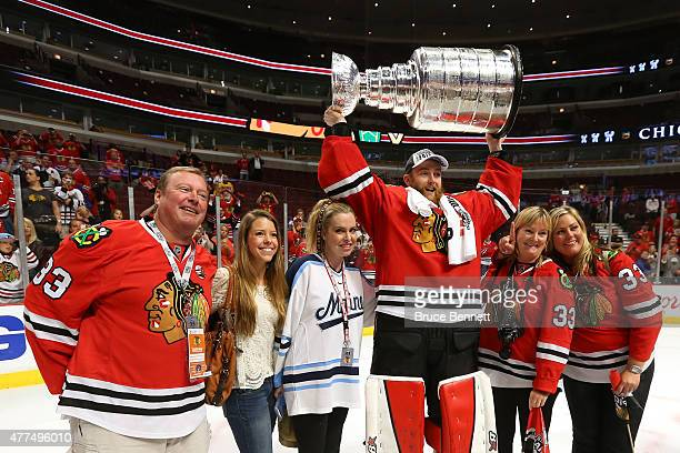 Scott Darling of the Chicago Blackhawks and his family pose with the Stanley Cup after defeating the Tampa Bay Lightning by a score of 20 in Game Six...