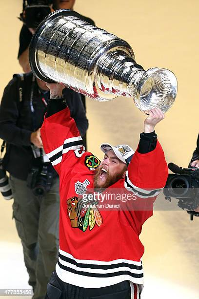 Scott Darling of the Chicago Blackhawks celebrates with the Stanley Cup after defeating the Tampa Bay Lightning by a score of 20 in Game Six to win...