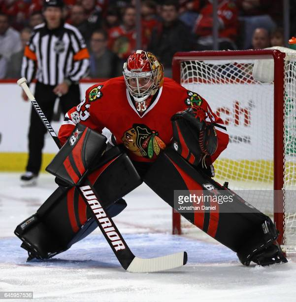Scott Darling of the Chicago Blackhawks follows the action against the St Louis Blues at the United Center on February 26 2017 in Chicago Illinois...