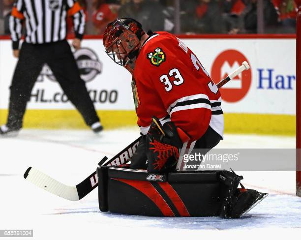 Scott Darling of the Chicago Blackhawks makes a save against the Colorado Avalanche at the United Center on March 19 2017 in Chicago Illinois