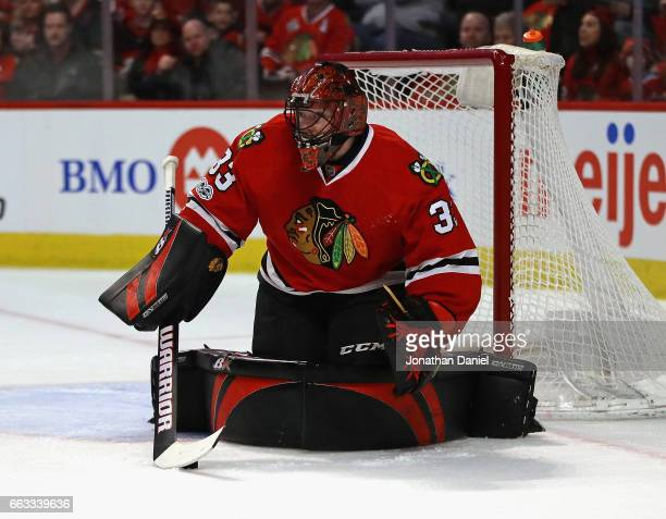 Scott Darling of the Chicago Blackhawks makes a save against the Colorado Avalanche at the United Center on March 19 2017 in Chicago Illinois The...