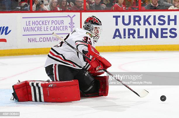 Scott Darling of the Chicago Blackhawks makes a save against the Ottawa Senators during an NHL game at Canadian Tire Centre on October 30 2014 in...
