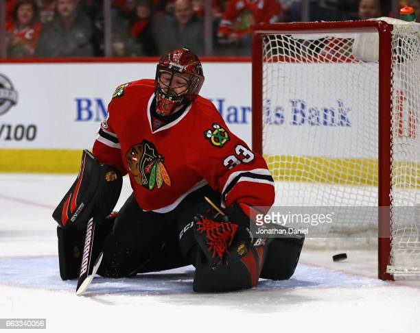 Scott Darling of the Chicago Blackhawks reacts after giving up a goal to the Colorado Avalanche at the United Center on March 19 2017 in Chicago...