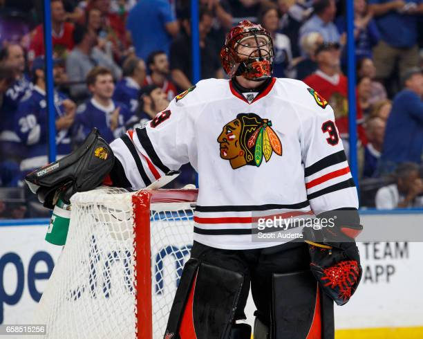 Scott Darling of the Chicago Blackhawks reacts to giving up a goal to the Tampa Bay Lightning during first period at Amalie Arena on March 27 2017 in...