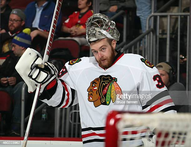 Scott Darling of the Chicago Blackhawks takes a break during the game against the New Jersey Devils at the Prudential Center on December 9 2014 in...