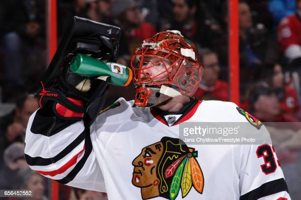 Scott Darling of the Chicago Blackhawks takes a drink during a break against the Ottawa Senators at Canadian Tire Centre on March 16 2017 in Ottawa...