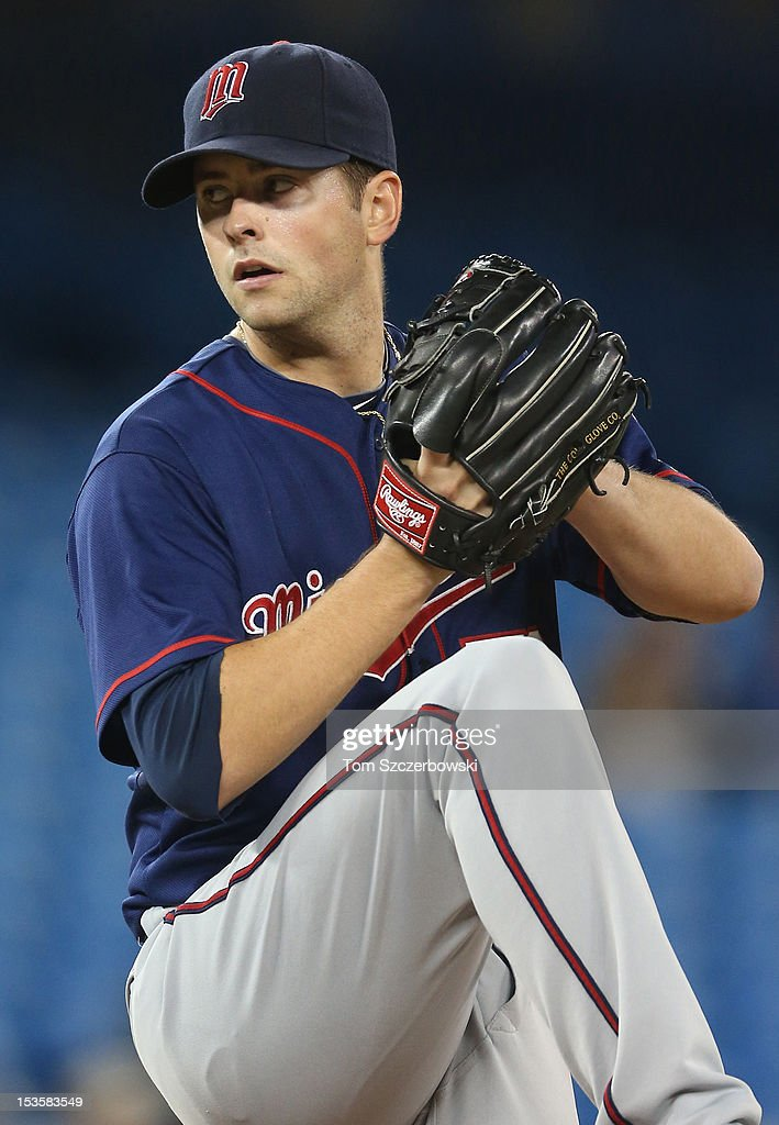 Scott Diamond #58 of the Minnesota Twins delivers a pitch during MLB game action against the Toronto Blue Jays on October 3, 2012 at Rogers Centre in Toronto, Ontario, Canada.