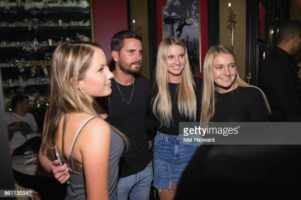 Scott Disick poses for a photo with fans at Sugar Factory American Brassiere on October 13 2017 in Bellevue Washington