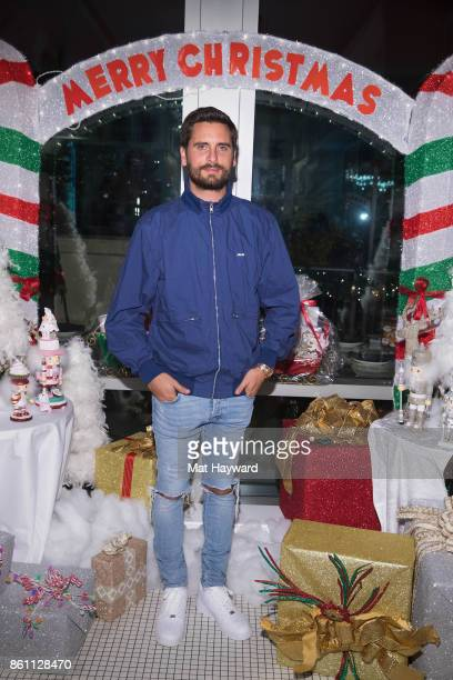 Scott Disick poses for a photo with items from the Mariah Carey Christmas Factory line at Sugar Factory American Brassiere on October 13 2017 in...