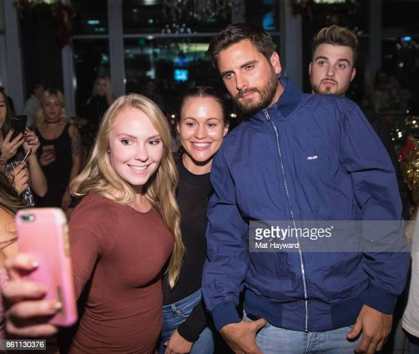 Scott Disick poses for a selfie with fans at Sugar Factory American Brassiere on October 13 2017 in Bellevue Washington