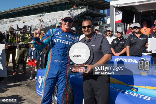 Scott Dixon celebrating his pole win on the second day of qualifications for the 101st Indianapolis on May 21 at the Indianapolis Motor Speedway in...