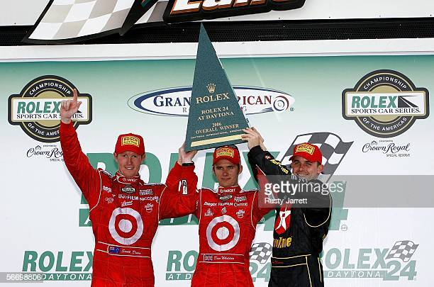 Scott Dixon Dan Weldon and Casey Mears drivers of the Target Chip Ganassi Racing Lexus Riley celebrate winning the 2006 Rolex 24 At Daytona on...