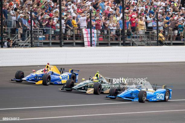 Scott Dixon driver of the Chip Ganassi Racing Honda Ed Carpenter driver of the Ed Carpenter Racing Chevrolet and Alexander Rossi driver of the...