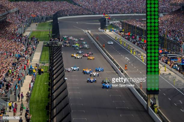 Scott Dixon driver of the Chip Ganassi Racing Honda leads the first to the green flag during the running of the 101st Indianapolis 500 on May 28th...