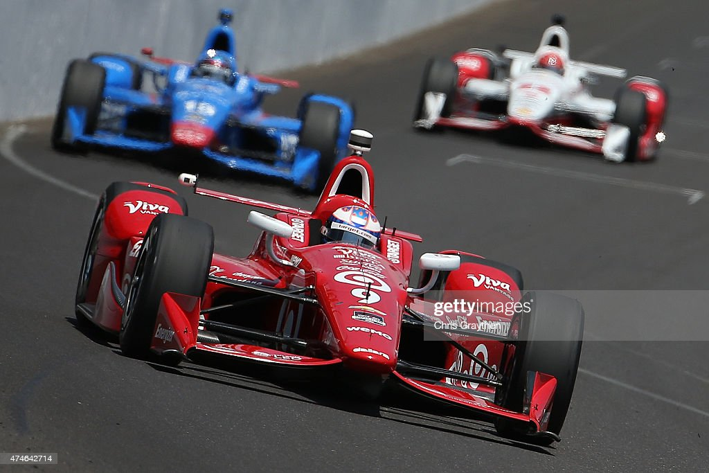 <a gi-track='captionPersonalityLinkClicked' href=/galleries/search?phrase=Scott+Dixon&family=editorial&specificpeople=183395 ng-click='$event.stopPropagation()'>Scott Dixon</a>, driver of the #9 Target Chip Ganassi Racing Chevrolet Dallara leads the field during the 99th running of the Indianapolis 500 mile race at Indianapolis Motorspeedway on May 24, 2015 in Indianapolis, Indiana.