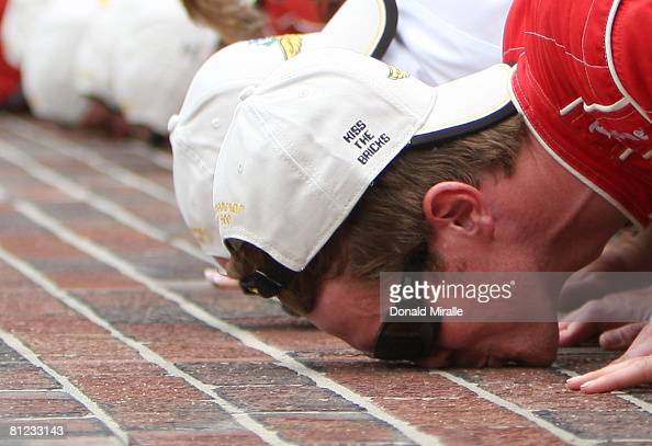 Scott Dixon driver of the Target Chip Ganassi Racing Dallara Honda kisses the yard of bricks after his victory during the IRL IndyCar Series 92nd...