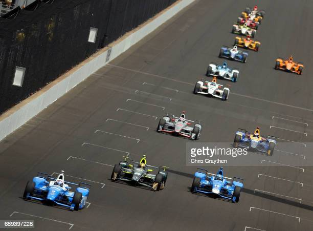 Scott Dixon of New Zealand driver of the Camping World Honda leads the field during the 101st running of the Indianapolis 500 at Indianapolis...