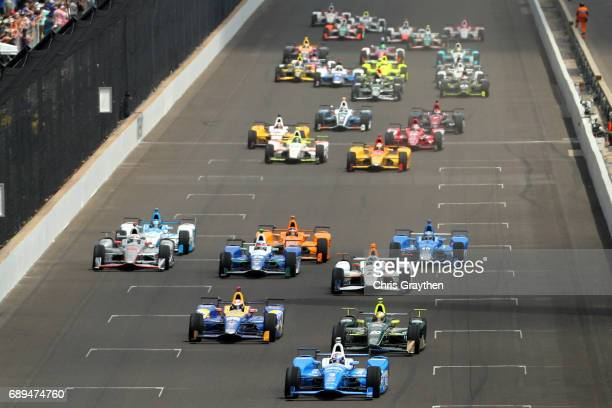 Scott Dixon of New Zealand driver of the Camping World Honda leads the field during during the 101st Indianapolis 500 at Indianapolis Motorspeedway...