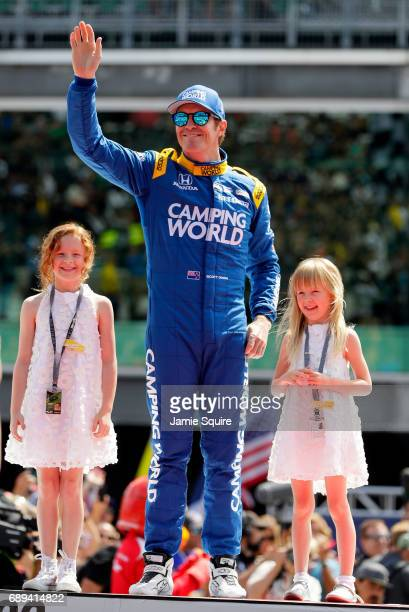 Scott Dixon of New Zealand driver of the Camping World Honda stands alongside his daughters during driver introductions ahead of the 101st running of...
