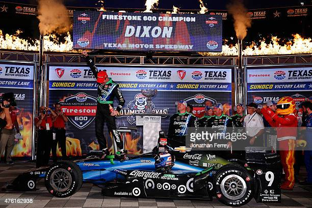 Scott Dixon of New Zealand driver of the Energizer Chevrolet celebrates in victory lane after winning the Verizon IndyCar Series Firestone 600 at...