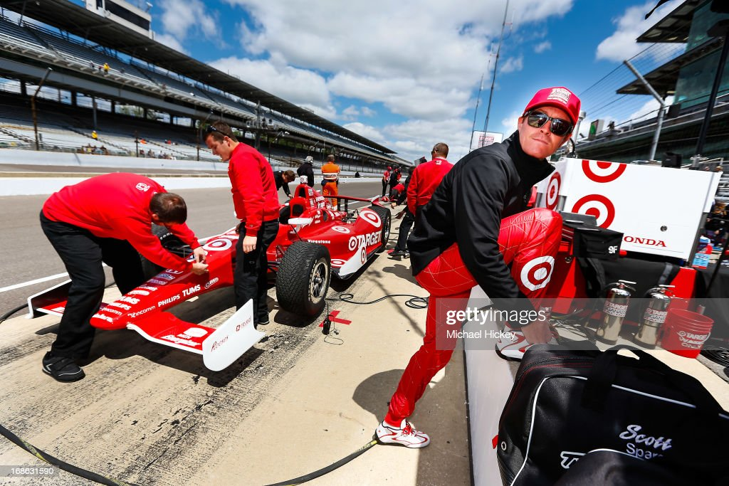 Scott Dixon of New Zealand, driver of the #9 Target Chip Ganassi Honda adjusts his shoes during Indianapolis 500 practice at the Indianapolis Motor Speedway on May 12, 2013 in Indianapolis, Indiana.
