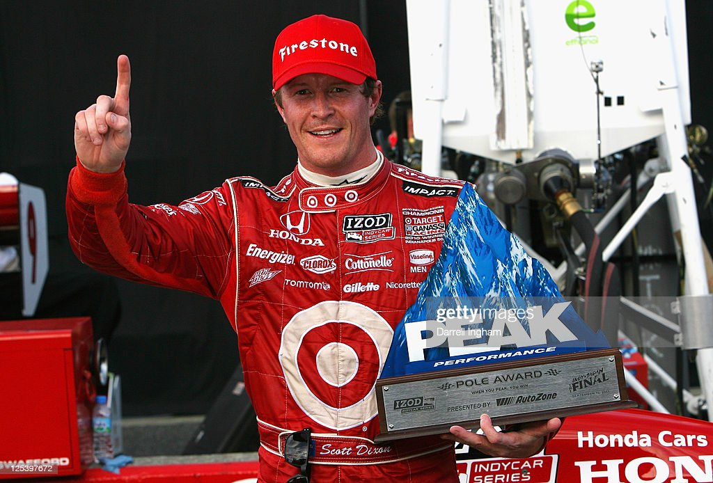 <a gi-track='captionPersonalityLinkClicked' href=/galleries/search?phrase=Scott+Dixon&family=editorial&specificpeople=183395 ng-click='$event.stopPropagation()'>Scott Dixon</a> of New Zealand driver of the #9 Target Chip Ganassi Racing Dallara Honda celebrates pole position for the Indy Japan 300 The Final on the road course at the Twin Ring Motegi on September 17, 2011 in Motegi, Japan.