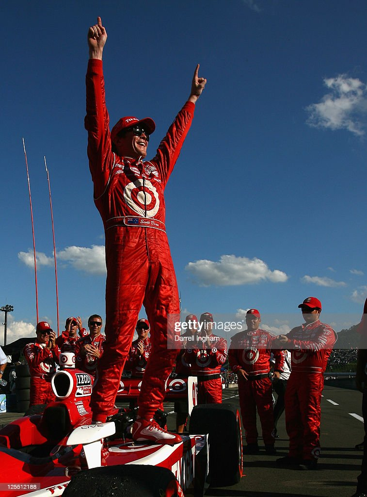 <a gi-track='captionPersonalityLinkClicked' href=/galleries/search?phrase=Scott+Dixon&family=editorial&specificpeople=183395 ng-click='$event.stopPropagation()'>Scott Dixon</a> of New Zealand, driver of the #9 Target Chip Ganassi Racing Dallara Honda celebrates winning the Indy Japan 300 The Final, on the road course at the Twin Ring Motegi on September 18, 2011 in Motegi, Japan.