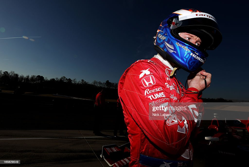 Scott Dixon of New Zealand, driver of the #9 Target Chip Ganassi Racing Honda adjusts his helmet prior to practice for the Honda Indy Grand Prix of Alabama at Barber Motorsports Park on April 6, 2013 in Birmingham, Alabama.