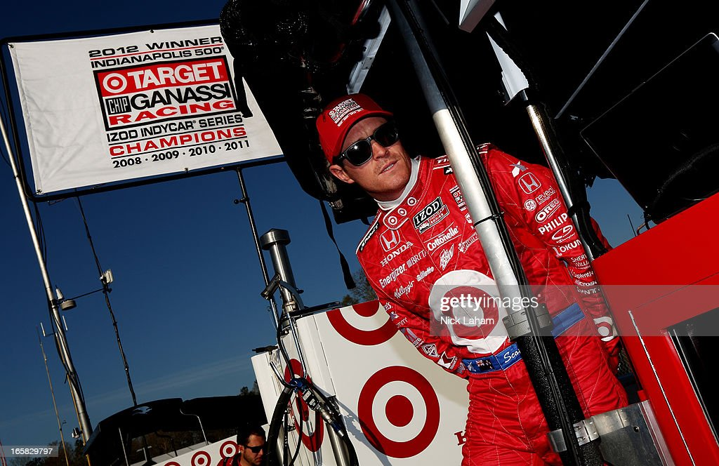 Scott Dixon of New Zealand, driver of the #9 Target Chip Ganassi Racing Honda stands in his pit box prior to practice for the Honda Indy Grand Prix of Alabama at Barber Motorsports Park on April 6, 2013 in Birmingham, Alabama.