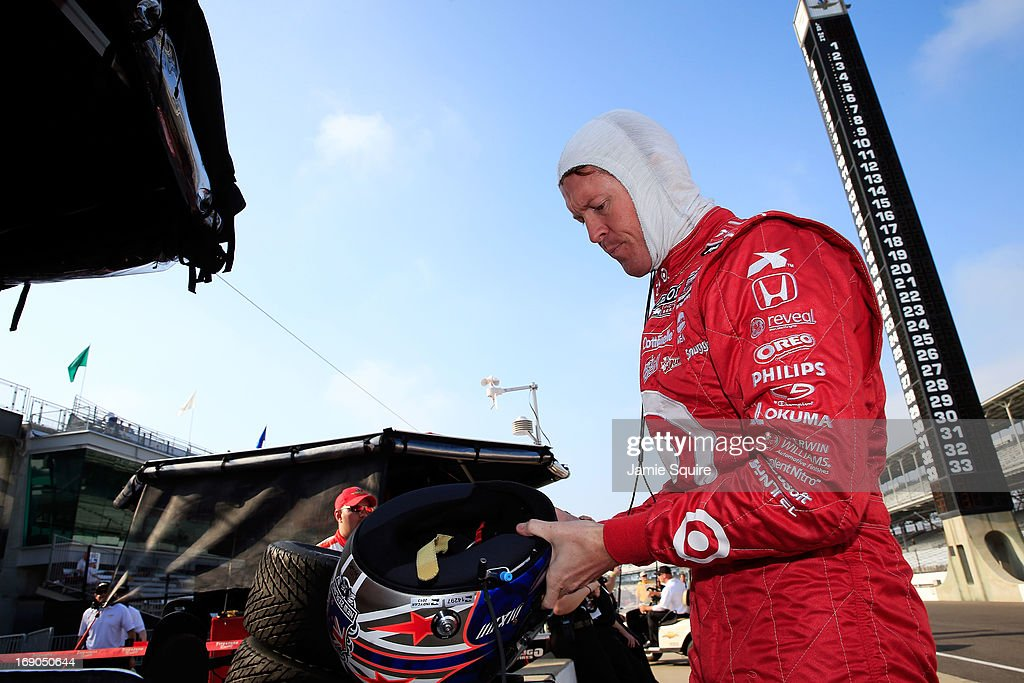 <a gi-track='captionPersonalityLinkClicked' href=/galleries/search?phrase=Scott+Dixon&family=editorial&specificpeople=183395 ng-click='$event.stopPropagation()'>Scott Dixon</a> of New Zealand, driver of the #9 Target Chip Ganassi Racing Honda, practices ahead of Bump Day qualifying at Indianapolis Motor Speedway on May 19, 2013 in Indianapolis, Indiana.