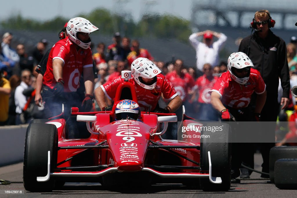<a gi-track='captionPersonalityLinkClicked' href=/galleries/search?phrase=Scott+Dixon&family=editorial&specificpeople=183395 ng-click='$event.stopPropagation()'>Scott Dixon</a> of New Zealand, driver of the #9 Target Chip Ganassi Racing Honda Dallara participates in the pit crew challenge on Carb Day for the 97th Indianapolis 500 mile race at Indianapolis Motor Speedway on May 24, 2013 in Indianapolis, Indiana.