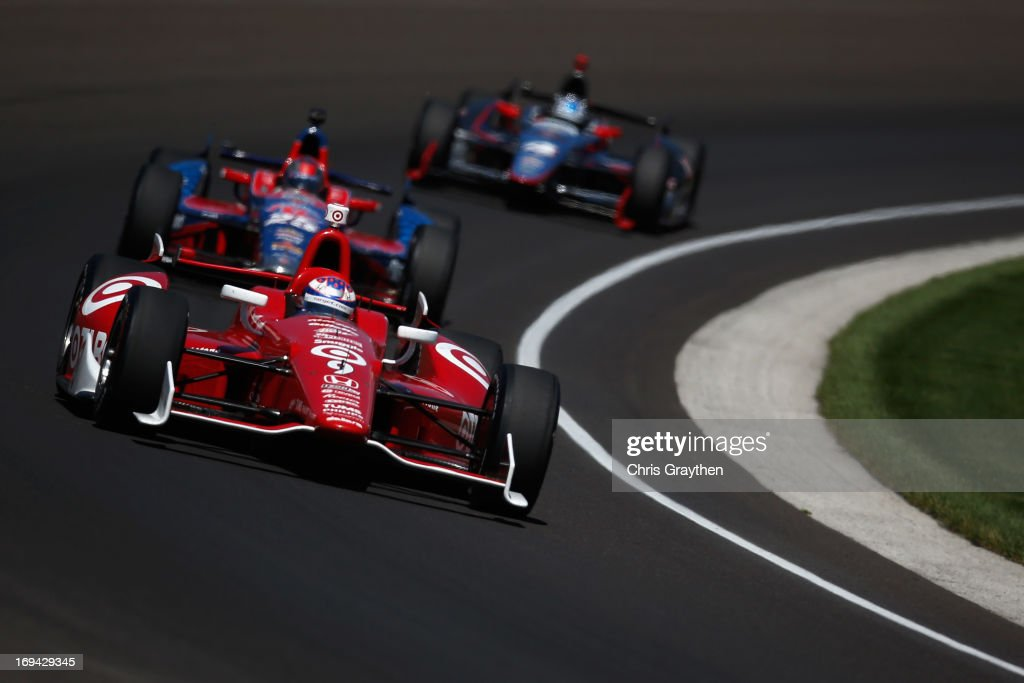 <a gi-track='captionPersonalityLinkClicked' href=/galleries/search?phrase=Scott+Dixon&family=editorial&specificpeople=183395 ng-click='$event.stopPropagation()'>Scott Dixon</a> of New Zealand, driver of the #9 Target Chip Ganassi Racing Honda Dallara leads a pack of cars during final practice on Carb Day for the 97th Indianapolis 500 mile race at Indianapolis Motor Speedway on May 24, 2013 in Indianapolis, Indiana.