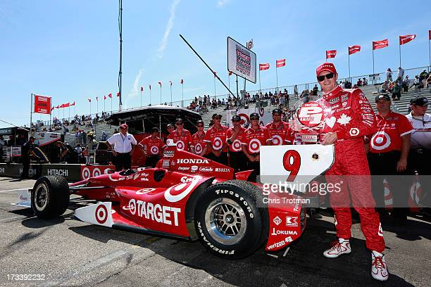 Scott Dixon of New Zealand driver of the Target Chip Ganassi Racing Honda poses with the Verizon P1 Pole Award following qualifying for the IZOD...