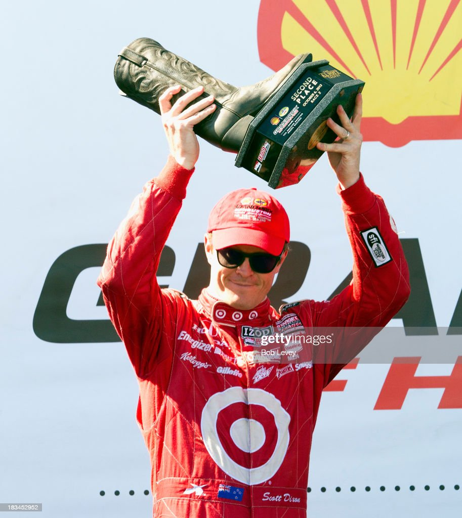 Scott Dixon of New Zealand, driver of the #9 Target Chip Ganassi Racing Honda Dallara, holds up the second place trophy during the Grand Prix of Houston, at Reliant Park on October 6, 2013 in Houston, Texas.