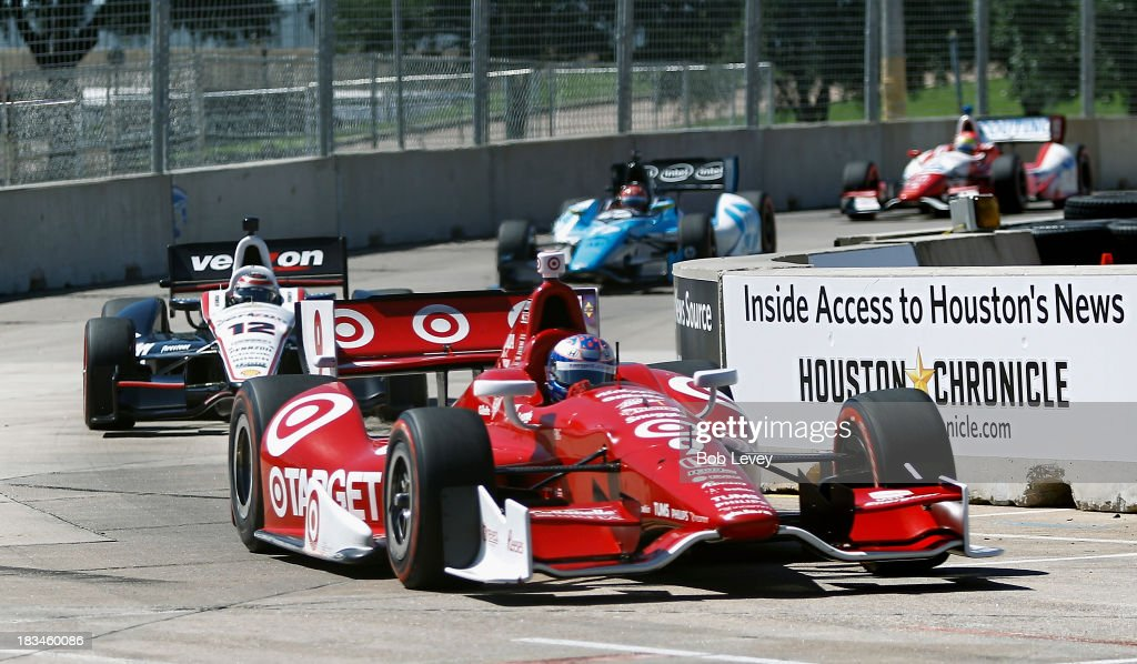 <a gi-track='captionPersonalityLinkClicked' href=/galleries/search?phrase=Scott+Dixon&family=editorial&specificpeople=183395 ng-click='$event.stopPropagation()'>Scott Dixon</a> of New Zealand, driver of the #9 Target Chip Ganassi Racing Honda Dallara, leads Will Power, driver of the #12 Team Penske car coming out of turn number 10 during the Shell And Pennzoil Grand Prix Of Houston Race #2 at Reliant Park on October 6, 2013 in Houston, Texas.