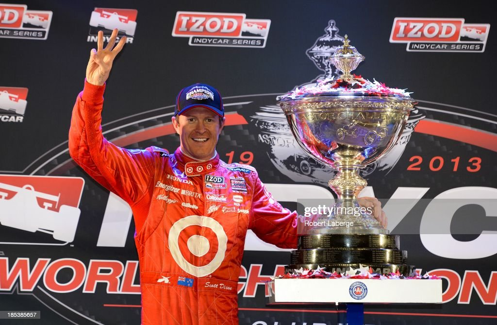 <a gi-track='captionPersonalityLinkClicked' href=/galleries/search?phrase=Scott+Dixon&family=editorial&specificpeople=183395 ng-click='$event.stopPropagation()'>Scott Dixon</a> of New Zealand driver of the #9 Target Chip Ganassi Racing Dallara Honda poses with the Astor Cup after winning the IZOD IndyCar Series Championship by finishing fifth at the IZOD IndyCar Series MAVTV 500 World Championship at the Auto Club Speedway on October 19, 2013 in Fontana, California.