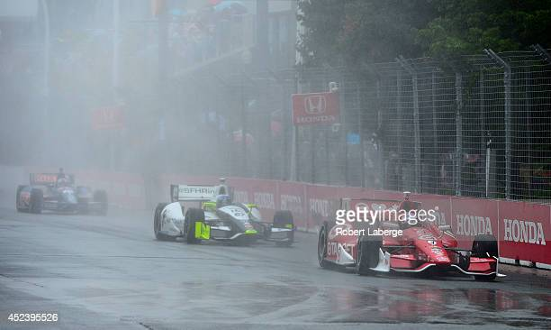 Scott Dixon of New Zealand driver of the Target Chip Ganassi Racing Dallara Chevrolet leads a pack of cars during parade laps of race 1 of the...