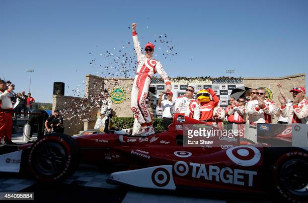 Scott Dixon of New Zealand driver of the Target Chip Ganassi Racing Chevrolet celebrates after winning the Verizon IndyCar Series GoPro Grand Prix of...