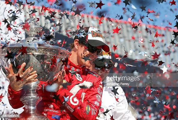 Scott Dixon of New Zealand driver of the Target Chip Ganassi Racing Chevrolet Dallara celebrates winning the Verizon IndyCar Series GoPro Grand Prix...