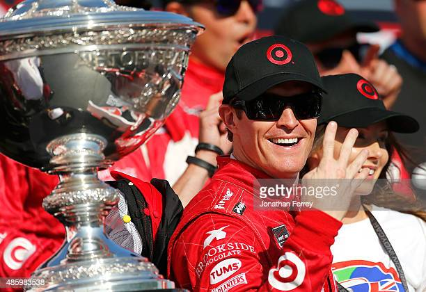 Scott Dixon of New Zealand driver of the Target Chip Ganassi Racing Chevrolet Dallara celebrates winning the Verizon IndyCar Series GoPro Grand Prix...