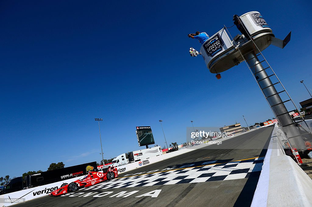 Scott Dixon of New Zealand driver of the Target Chip Ganassi Racing Chevrolet Dallara crosses the finish line and wins the IndyCar Championship for...