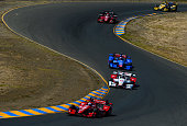 Scott Dixon of New Zealand driver of the Target Chip Ganassi Racing Chevrolet Dallara leads a pack of cars during the Verizon IndyCar Series GoPro...