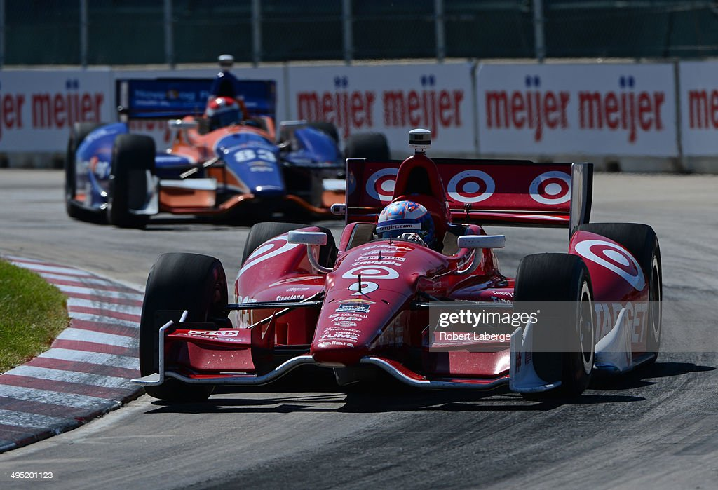 <a gi-track='captionPersonalityLinkClicked' href=/galleries/search?phrase=Scott+Dixon&family=editorial&specificpeople=183395 ng-click='$event.stopPropagation()'>Scott Dixon</a> of New Zealand, driver of the #9 Target Chip Ganassi Racing Dallara Chevrolet, leads <a gi-track='captionPersonalityLinkClicked' href=/galleries/search?phrase=Charlie+Kimball&family=editorial&specificpeople=7404865 ng-click='$event.stopPropagation()'>Charlie Kimball</a>, driver of the #83 Chip Ganassi Racing Teams Dallara Chevrolet during the Verizon IndyCar Series Chevrolet Indy Dual in Detroit Dual II race at Belle Isle Park on June 1, 2014 in Detroit, Michigan.