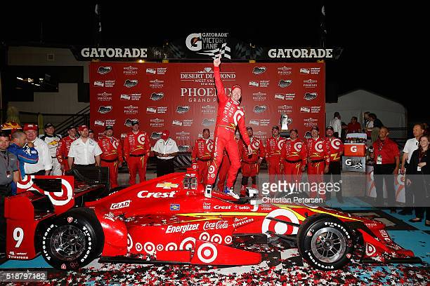 Scott Dixon of New Zealand driver of the Target Chip Ganassi Racing Chevrolet IndyCar celebrates after winning the Phoenix Grand Prix at Phoenix...