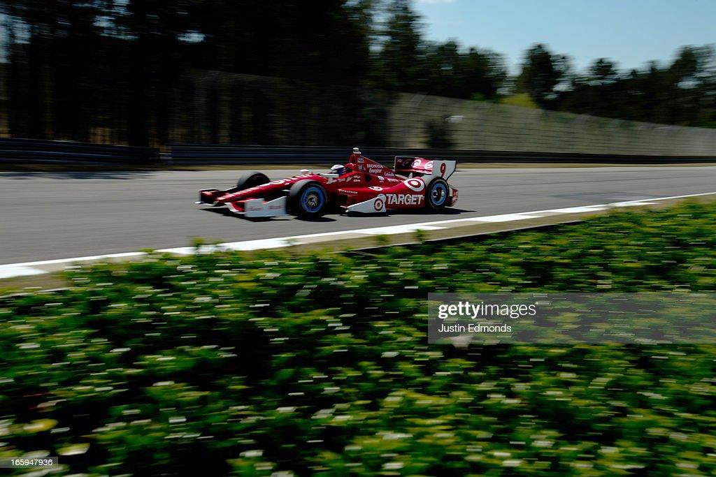 Scott Dixon of New Zealand, drives the #9 Target Chip Ganassi Racing Honda during warm up for the Honda Indy Grand Prix of Alabama at Barber Motorsports Park on April 7, 2013 in Birmingham, Alabama.