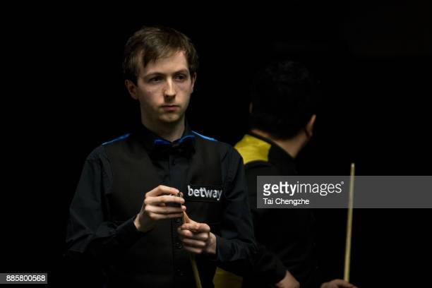 Scott Donaldson of Scotland chalks the cue during his third round match against Li Hang of China on day 8 of 2017 Betway UK Championship at Barbican...